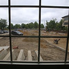 Tour of Thorndike Exchange mixed use development. Looking toward Thorndike Street from second floor lounge. This will be a new 9-story building. The foundation has already been built. (SUN/Julia Malakie)