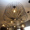 Lupoli Companies CEO Sal Lupoli gives a tour of Thorndike Exchange mixed use development. One of the unusual light fixtures in a residents' lounge. (SUN/Julia Malakie)