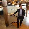 Lupoli Companies CEO Sal Lupoli gives a tour of Thorndike Exchange mixed use development. This is the main entrance on the east side. At left rear will be a cafe. (SUN/Julia Malakie)