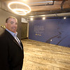 Lupoli Companies CEO Sal Lupoli gives a tour of Thorndike Exchange mixed use development. Each floor is named after a famous Lowell resident. First floor is Ben Butler. (SUN/Julia Malakie)