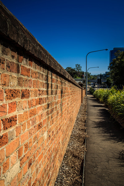 Parramatta, NSW, Australia<br /> Superb convict-built brick wall surrounding St John's Cemetery. Replacing an earlier bank-and-ditch enclosure (which had fallen into disrepair), the wall was paid for by public subscription and constructed around 1820.