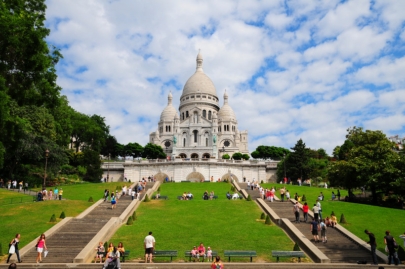 "The Sacré-Cœur Basilica <br /> <br /> (French: Basilique du Sacré-Cœur, ""Basilica of the Sacred Heart"", pronounced [sakʁe kœʁ]), a Roman Catholic basilica, is a popular landmark in Paris, France, dedicated to the Sacred Heart of Jesus. The basilica is located at the summit of the butte Montmartre, the highest point in the city."
