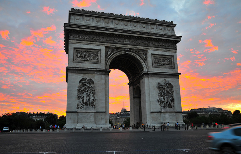 "The Arc de Triomphe is a monument in Paris, France that stands in the centre of the Place Charles de Gaulle, also known as the ""Place de l'Étoile"". It is at the western end of the Champs-Élysées. The triumphal arch honors those who fought for France, particularly during the Napoleonic Wars. On the inside and the top of the arc there are all of the names of generals and wars fought. Underneath is the tomb of the unknown soldier from World War I ."