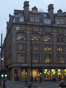 """I believe this is a building with downtown flats or offices that you could buy for just under a million pounds a piece... the sign on the building reads """"Piccadilly W1, City of Westminster."""""""