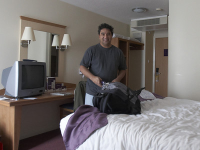 Shawn gleefully unpacks in our Heathrow Airport hotel room.  That's bedhead. :)