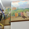 Tour of renovated and expanded Coburn Hall at UMass Lowell South Campus, originally the Lowell Normal School, founded to train teachers. Cassandra Long, paintings conservator with Gianfranco Pocobene Studio, works on restoration of the mural. (SUN/Julia Malakie)