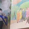 Tour of renovated and expanded Coburn Hall at UMass Lowell South Campus, originally the Lowell Normal School, founded to train teachers. Cassandra Long of Manhattan, a paintings conservator with Gianfranco Pocobene Studio, works on restoration of the large WPA-era mural. (SUN/Julia Malakie)