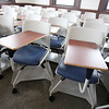 """Tour of renovated and expanded Coburn Hall at UMass Lowell South Campus, originally the Lowell Normal School, founded to train teachers. Current campus standard desks, swivel to work right or left-handed, and are on wheels. Floor is first use on campus of """"Chillewich"""", a durable material similar to place mats. (SUN/Julia Malakie)"""