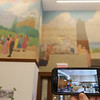 Tour of renovated and expanded Coburn Hall at UMass Lowell South Campus, originally the Lowell Normal School, founded to train teachers. A view of the mural before it was uncovered. (SUN/Julia Malakie)