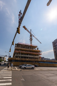 A Crane lifts material at the Post Office High Rise Complex