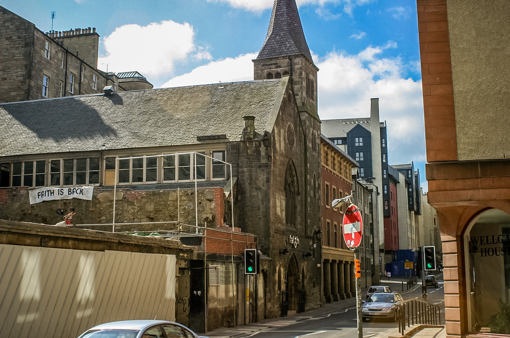 Edinburgh, Scotland<br /> Looking along the Cowgate from the bottom of Blair St. Visible are the Faith Nightlub, Cunningham House (a short-stay hostel for the homeless) next door and Wellgate House on the right.