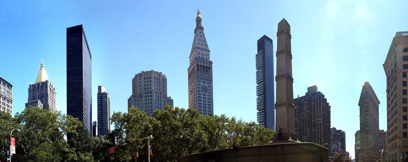 Madison Square Park. (l. to r.) New York Life Bldg, Merchandise Mart Bldg., Met Life North Bldg., Met Life Tower, One Madison Park, Worth Monument, Flatiron Bldg.