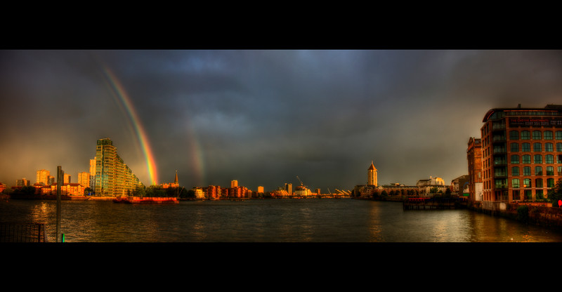 Pot of gold<br /> <br /> If you ever wondered where that pot of gold at the end of the rainbow is....?<br /> Looks like it's in a church in Battersea.<br /> <br /> Panorama of the Thames between showers.