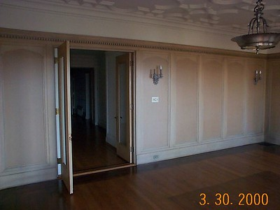 Original dining room. The offset doors to the hallway and the poorly planned installation of an elevator in 1949 ruined the original symmetry.