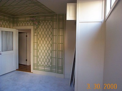 Original sleeping porch. This room had hand-painted roses-and-latticework wallpaper and wall-to-wall carpet over a raised floor, unlike the rest of the house. During renovation, it was discovered that the wallpaper covered the original exterior redwood siding, and the raised floor covered the original gravel-and-tar roof.