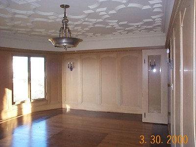 Original dining room. The beautiful original ceiling (horsehair and plaster) was cracked and sagging in places. The dark paneling turned out to be paper-thin veneer over original wallpaper.