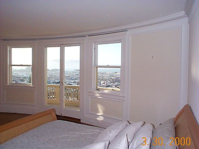 Original balcony doors and windows in master bedroom.