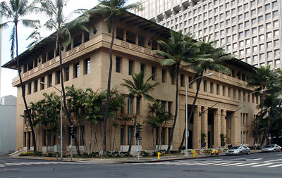 "The Alexander & Baldwin Building -- the ""A&B"" -opened in 1929.     The -architects C.W. Dickey and Hart Wood combined their design skills to create a memorial to S.T. Alexander and H.P. Baldwin, founders of one of Honolulu's ""Big Five"" industries.   The building's signature is the ""Dickey-style"" overhanging tile roof that provides a lid for a wide fourth-floor balcony.  Dickey and Wood, added a wild melange of Chinese, Hawaiian, Japanese, Italian, Moorish and Tibetan influences. There are also recurring Chinese good-luck symbols in the bronze grilles scattered through the building.Honolulu, O'ahu, Hawai'i"