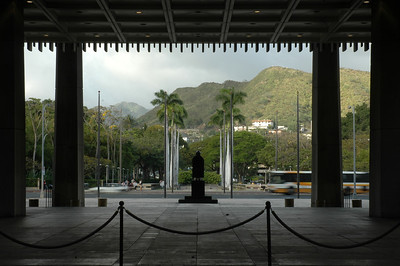 Hawaii State Capitol Building  The bronze statue of Father Damien  faces mauka (towards the mountains) toward the War Memorial with an eteranal flame and towards Punchbowl.