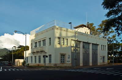 "Central Fire Station on Beretania St. The Central Fire Station was designed by architect Charles Dickey and engineer John Young in the ""moderne"" style, with geometric Art Deco details and materials. It has decorative belts, lines of louvers and sleek, aluminum Art Deco garage doors -- a story and a half tall -- created by the California Artistic Metal and Wire Company of San Francisco. The building is five bays wide; the three garage bays occupy the middle spaces. The end bays contain windows of heavy, tinted plate glass.  In 1870, the tallest landmark in Honolulu was the bell tower of Central Fire Station, then located on Union Street. At night, a watchman would sit in the tower, ready to sound the alarm if he spotted a fire. Central Fire Station was later relocated to its present site at Beretania and Fort Streets.   It's said to be haunted  Honolulu, O'ahu, Hawai'i"
