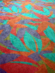 Carpet showing color scheme and pattern that is repeated on the auditorium seats.
