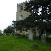 The church tower and churchyard (graveyard).