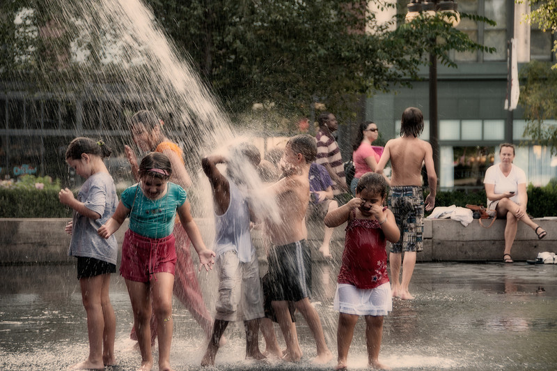 """Enjoying the water of """"The Crown Fountain"""" by artist Jaume Plensa, in Millenium Park, Chicago,IL"""