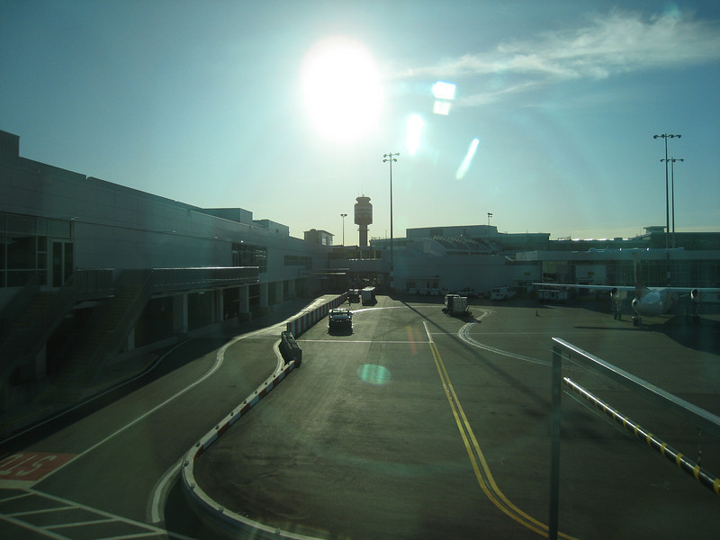 A view across the tarmac back to the control tower, from the end of C-pier.