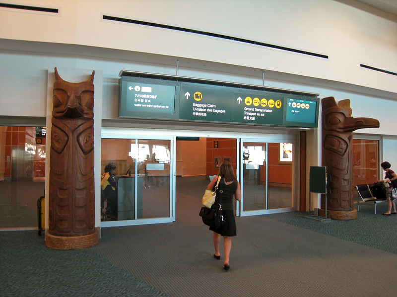 Two small totem poles guard the exit from the secure area, towards baggage claim.
