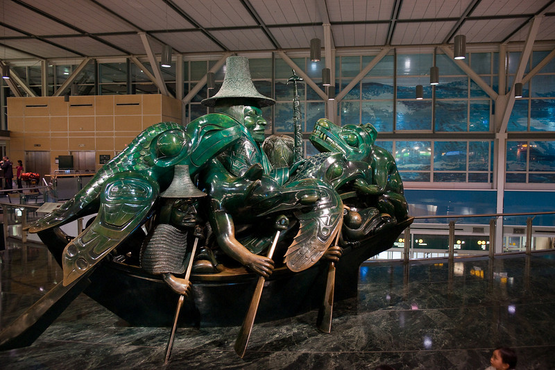 """""""The Spirit of Haida Gwaii,"""" one of Bill Reid's most famous sculptures.  Also known as the Jade Canoe, it's not actually made of jade, but rather is cast in bronze with a jade patina.  This sculpture sits in the middle of the international terminal departures area."""