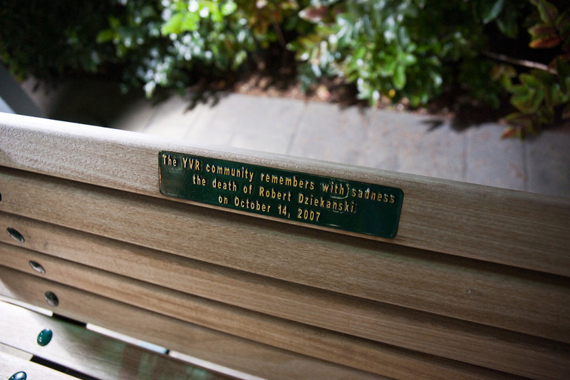 """The """"secret"""" memorial to Robert Dziekanski, who died at the airport in 2007 after being tasered by an RCMP officer, is a park bench tucked into a small park in front of the terminal building."""