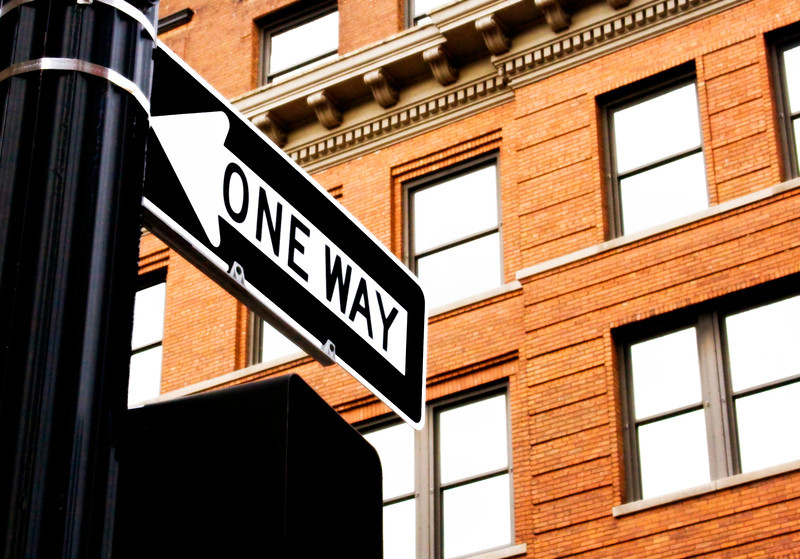 One way sign by the Waters Building in Grand Rapids, Michigan.