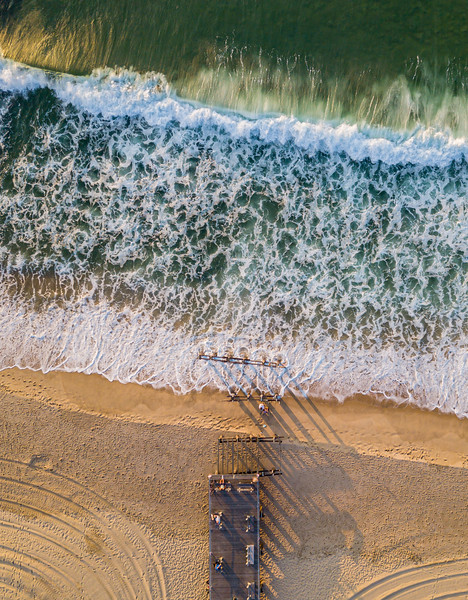 An Aerial View Of Ocean Grove Pier and Tractor Lines In The Sand and Gorgeous Green Ocean Waves 7/3/20