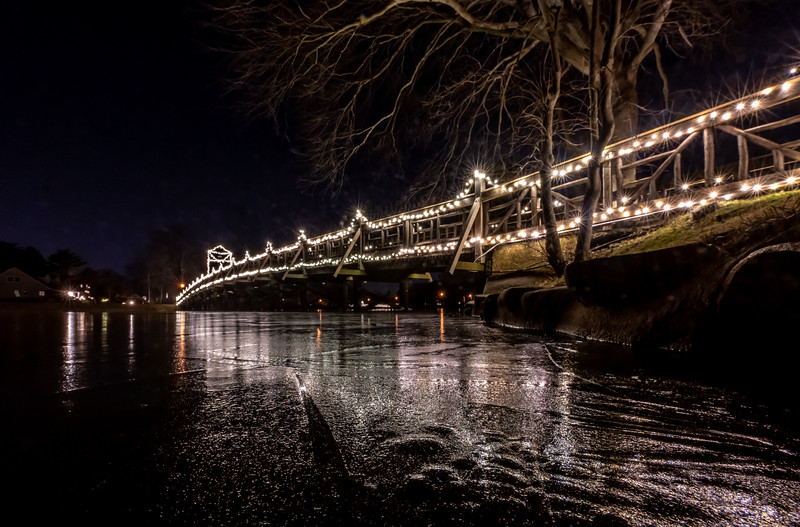 Christmas Lights On Footbridge Reflecting On Icy Lake In Spring Lake 12/21/19