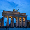 Tourists at the Brandenburg Gate in Berlin in the evening