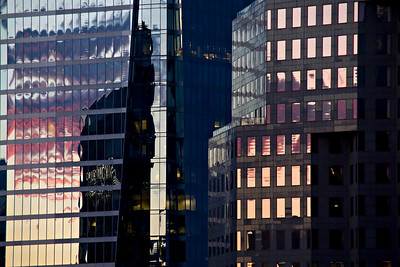 Sunset captured in the reflective facades of tower blocks in Downtown Vancouver.  Taken from the tenth floor of the incredible Sutton Place Hotel on Burrard Street.