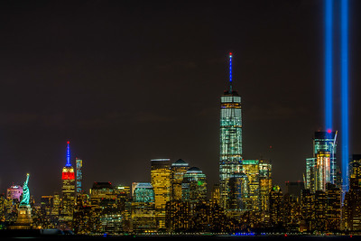 The Tribute in Light with the Statue of Liberty, Empire State Building and Freedom Tower 9/11/15