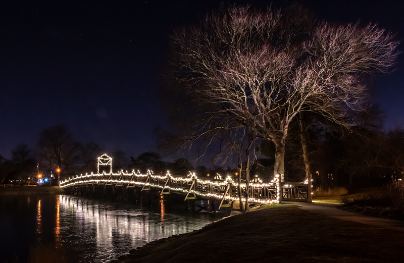 Christmas Lights On Footbridge Reflecting On Icy Lake In Spring Lake 12/21/19