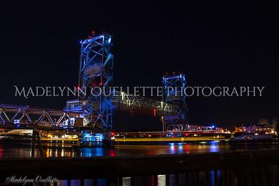 Portsmouth Tugs pass under Memorial Bridge
