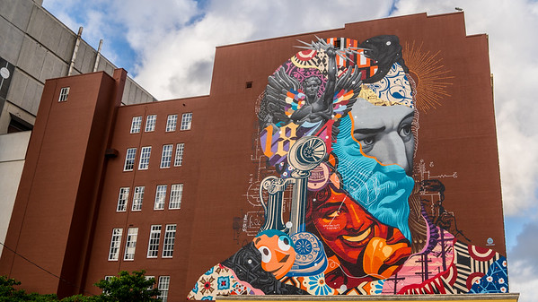 This mural amid the downtown buildings in the City of West Palm Beach, FL was painted by a very talented artist, Tristan Eaton. It adorns the first telephone Central Office in the city but was replaced by the industrial grey building that can be seen next door.