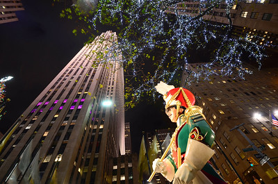 Rockefeller Center, December 2012.  Photo taken w/o a tripod.  Using only a remote IR shutter release and the lens hood for a stand on a concrete planter.