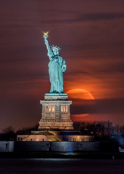 Full Moon Setting Behind The Statue of Libery 12/13/16