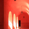 "Sunlit Pink Arches in the hallway of the Spanish colonial Catholic, mission convent ""San Bernardino de Siena"", in Valladolid, Mexico"