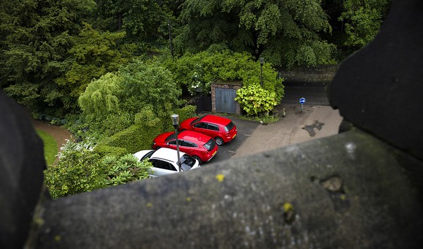 This one appealed to me - taken from a stone turret amongst lush woodland with modern splashes of colour like the cars and road signs standing-out against the varying foliage shades.