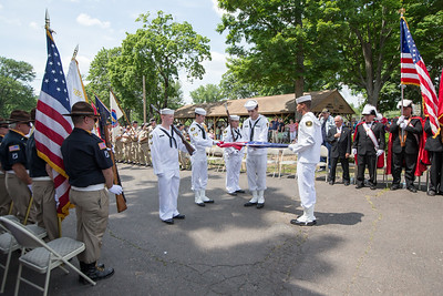 US Naval Sea Cadets demonstrate how to fold the flag Sunday during the American Legion Post 45 Watch Fire ceremonies in Meriden Jun. 14, 2015 | Justin Weekes / For the Record-Journal