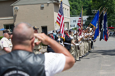 Gary Deschene of Milford salutes as the color guard enters Sunday during the American Legion Post 45 Watch Fire ceremonies in Meriden Jun. 14, 2015 | Justin Weekes / For the Record-Journal