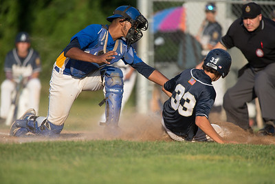 Meriden's catcher Jeff Morales (46) tries to pick off Bethel's Will Huegi (33) at home Wednesday during the American Legion 17U tournament at Ceppa Field in Meriden Jul. 29, 2015 | Justin Weekes / For the Record-Journal