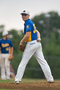 Meriden's Jeff Massicotte (36) checks the runner at first Thursday during the American Legion Junior southern divisional finals at Ceppa Field in Meriden Jul. 30, 2015 | Justin Weekes / For the Record-Journal