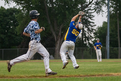 Meriden's Frank Palumbo (50) brings in a pop fly from Stamford's Mike Grafstein (8) Thursday during the American Legion Junior southern divisional finals at Ceppa Field in Meriden Jul. 30, 2015 | Justin Weekes / For the Record-Journal