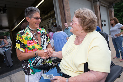 Organizer Marcia Phelps welcomes Rita Gagnon of Southington Saturday for the Milldale School Reunion at Engine Company 3 on Clark Street in Milldale Jul. 18, 2015   Justin Weekes / For the Record-Journal